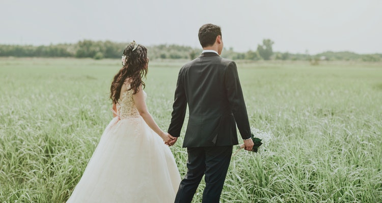 Happy Wedding Couple Walk Together